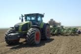 CLAAS изучает эффективность работы трактора AXION на посевных работах